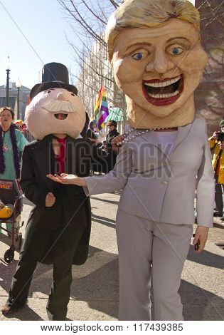 Hillary Holds Out Hand To Mr. Moneybags In The Mardi Gras Parade