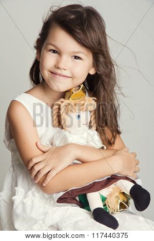 Beautiful girl playing with her doll