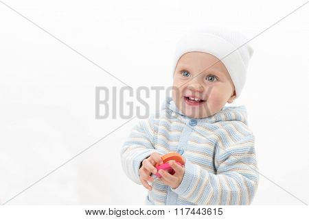 little child baby caucasian boy 1 year portrait face warm clothing hat smiling happy cheerful isolated on white studio shot teeth toothy smile
