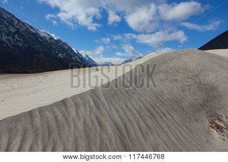 Dunes in the hills on the site of a mountain river