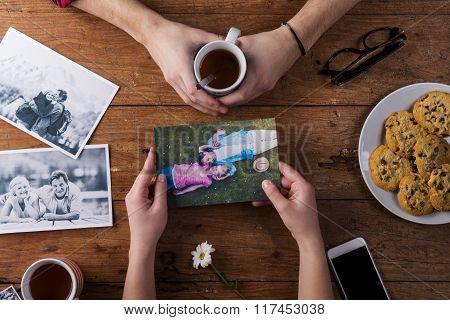 Mans and womans hands. Black-and-white photos. Couple. Tea, cookies, phone.