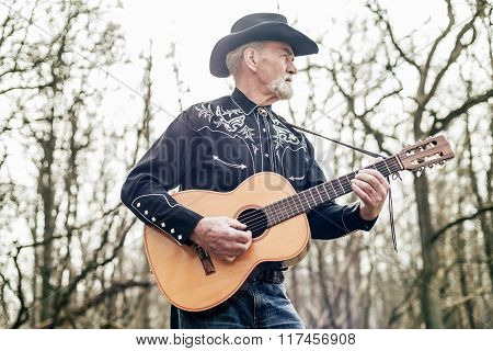Country Musician Strumming His Guitar