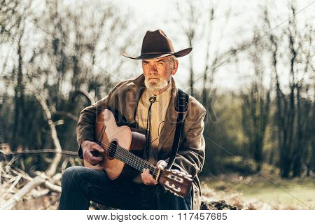 Senior Man Playing Country Music