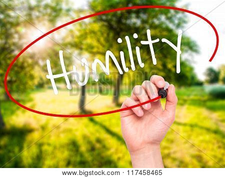 Man Hand Writing Humility  With Black Marker On Visual Screen.