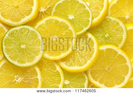 heap of fresh lemon and lime slices - full frame