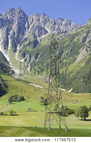 electricity pylons crossing the Swiss Alps. Bern Canton, Switzerland