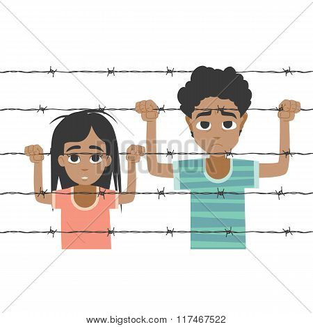 Refugee boy and girl behind barbed wire