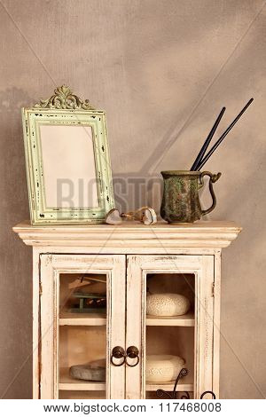 Retro home interior with show-case, frame and paintbrush.