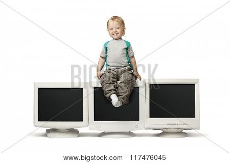 boy sit on CRT monitor isolate on white