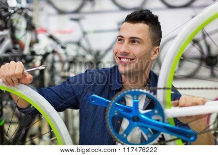 Man working in bicycle repair shop