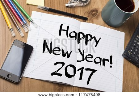 Happy New Year 2017 - Note Pad With Text On Wooden Table