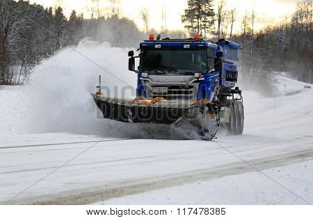 Scania Truck With Snowplow Clears Highway