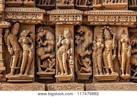 Stone carving bas relief sculptures on Adinath Jain Temple, famous indian tourist site Khajuraho, Madhya Pradesh, India