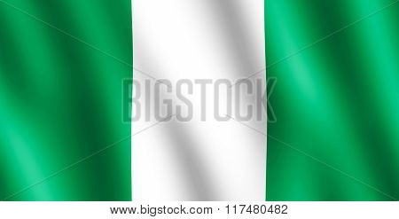 Flag of Nigeria waving in the wind giving an undulating texture of folds in the fabric. The Image is in the official ratio of the flag - 1:2.