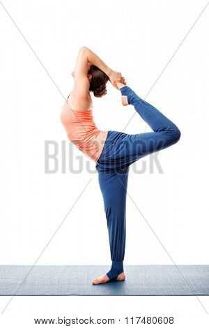 Beautiful sporty fit woman doing yoga asana Natarajasana - Lord of the dance pose isolated on white