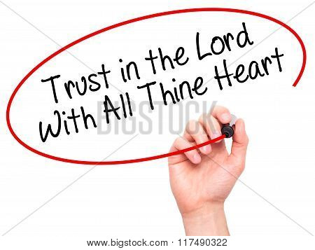 Man Hand Writing Trust In The Lord With All Thine Heart With Black Marker On Visual Screen
