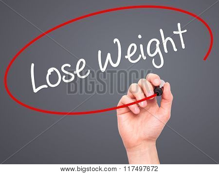 Man Hand Writing Lose Weight With Black Marker On Visual Screen