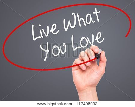 Man Hand Writing Live What You Love  With Black Marker On Visual Screen