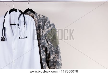 Medical White Consultation Coat And Military Uniform On Hanger