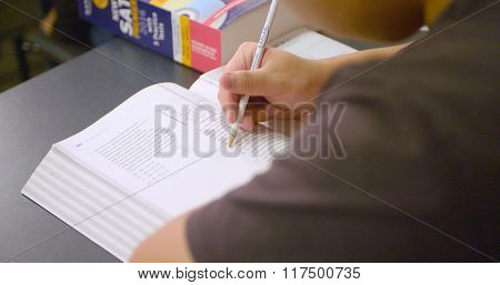 Student works on practice problems for SAT standardized test