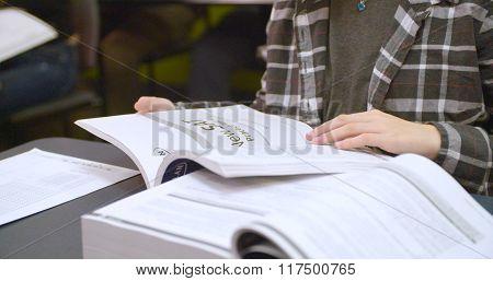 Student reads practice SAT standardized test