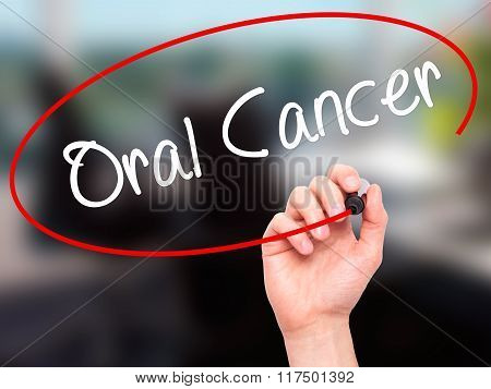 Man Hand Writing Oral Cancer With Black Marker On Visual Screen.