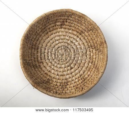 single wicker basket isolated on white background