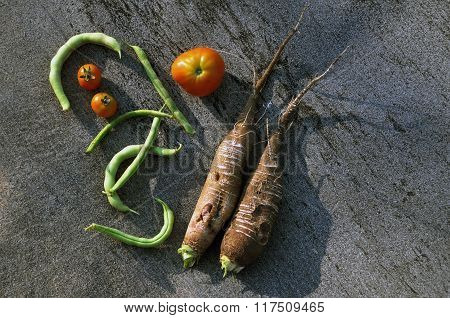 fresh fruits vegetables on a dark background
