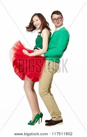 Confident positive young couple dancing