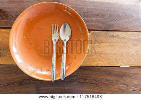 Empty Dish After Food On Wooden Table