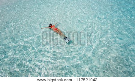 Woman floating with snorkeling gear