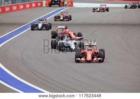 Kimi Raikkonen Scuderia Ferrari and Valtteri Bottas Williams Martini Racing warming their tires