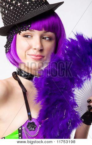 Young disco girl with pinc fan