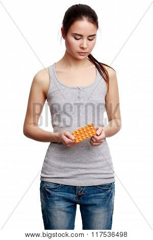 Young Serious Woman Holding Meds In The Hands