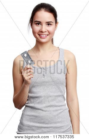 Young Smiling Woman Holding Meds In The Hands