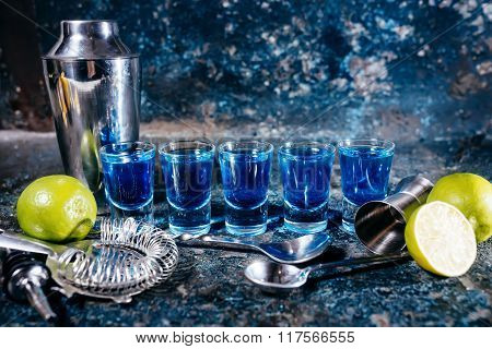 Blue Curacao Shots, Alcoholic Strong Drinks. Cocktails And Garnish At Bar, Pub Or Restaurant