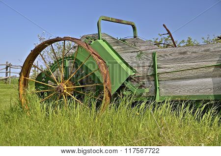 Steel wheeled old wooden manure spreader.
