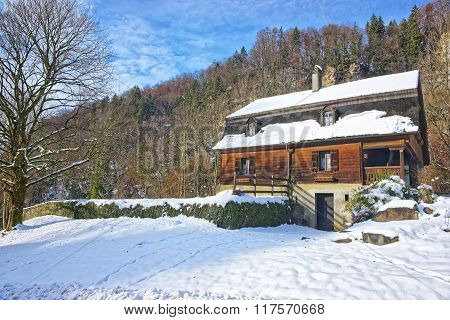 House near Salt Mine of Bex in winter Switzerland. The Salt Mining Complex is listed as Swiss heritage site of national significance.
