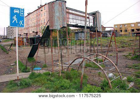 Old Rusty Damaged Playground At Chersky Town District Kolyma Region