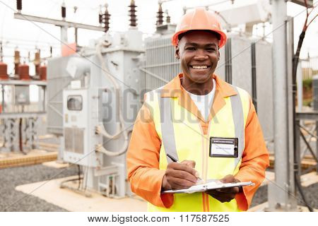 portrait of african american electricity company worker in substation