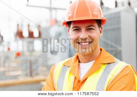 young male electrical engineer at substation