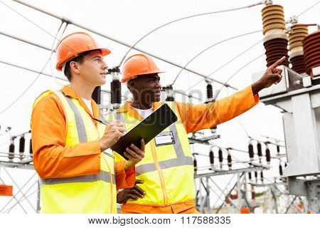 senior technician and electrician working together in power plant