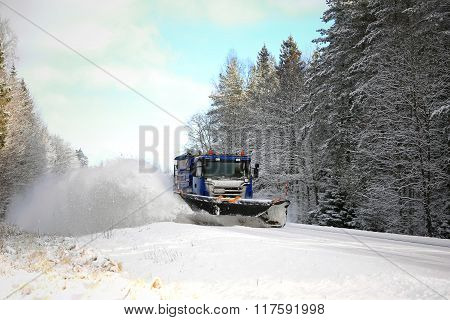 Snowplow Clears Scenic Road
