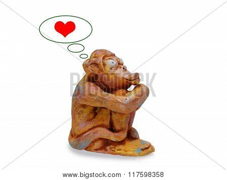 Sad Monkey From Clay Pottery  Dreams About Love. Isolated On White