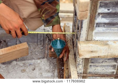 Labor Man Using A Plumb Bob For Check .