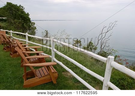 Chairs And Fence On Beach.