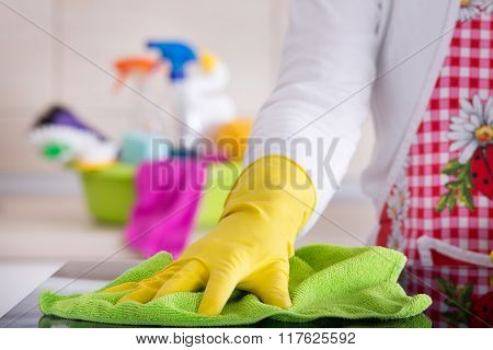 Woman Cleaning Glass Table