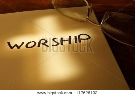Book with word Worship.