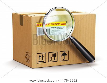 Cardboard box parcel with tracking number and magnifying glass