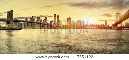 Manhattan and Brooklyn Bridges and Manhattan skyline At Night